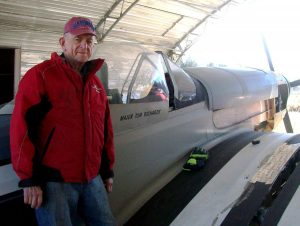 Air Park owner Tommy Richards, in a hangar with a ¾ replica of a P-51 Mustang under construction. Richards plans to resume air show activities at the field.
