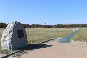 The First Flight Boulder and the Flight Line mark the location where the first flights on December 17, 1903 took off and landed.