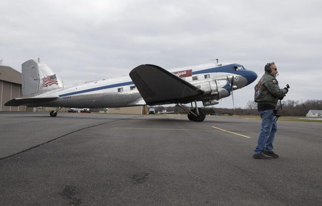 Luke Curtas, owner of Shannon Airport, walks past the Stars and Stripes, a vintage DC-3, after it arrived at Shannon Airport in Fredericksburg, VA on Wednesday, Jan 6, 2021. Photo by Mike Morones/ The Free Lance-Star