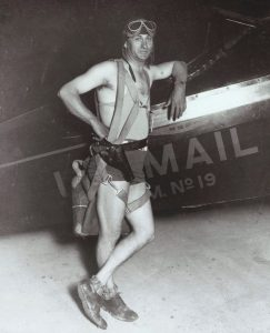 Dick Merrill is pictured here with a Pitcairn Mailwing