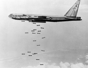 A Boeing B-52F-65-BW Stratofortress, 57-0144, drops bombs during an Arc Light strike. (U.S. Air Force)