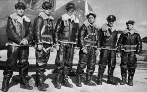 """First Lieutenant James M. Stewart, USAAF, (third from left) as a pilot at the Training Command Bombardier School, Kirtland AAF, Albuquerque, New Mexico, 1942. (U.S. Air Force) Update: The first student on the left has been identified as John M. """"Jack"""" Drenan. 1st Lieutenant Drenan, a B-24 bombardier, was listed as Missing in Action on a mission to the Marshall Islands, 2 January 1944. Thanks to Mr. Patrick E. Freudenthal for the information."""